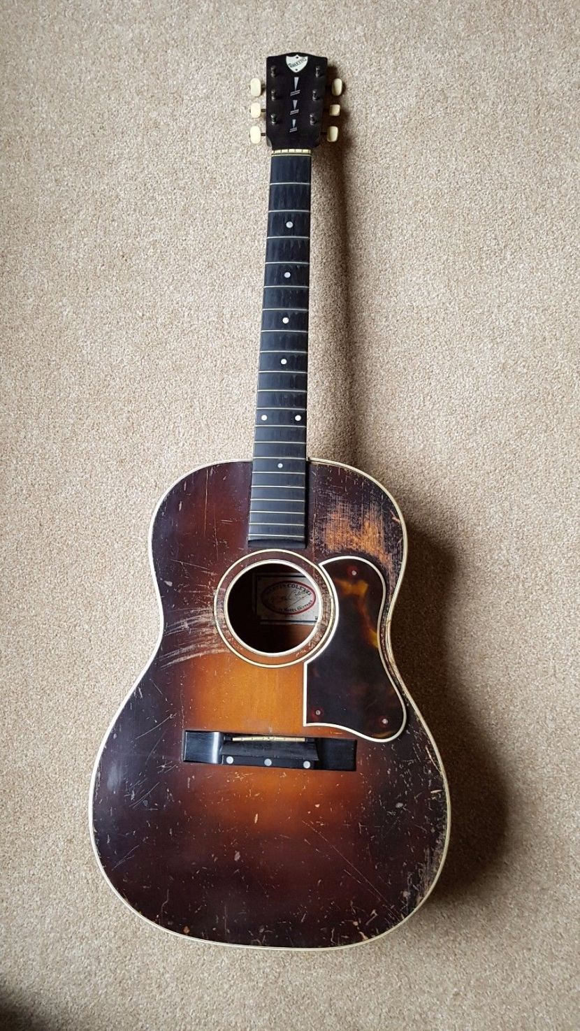 A battered Martin Coletti G40 guitar