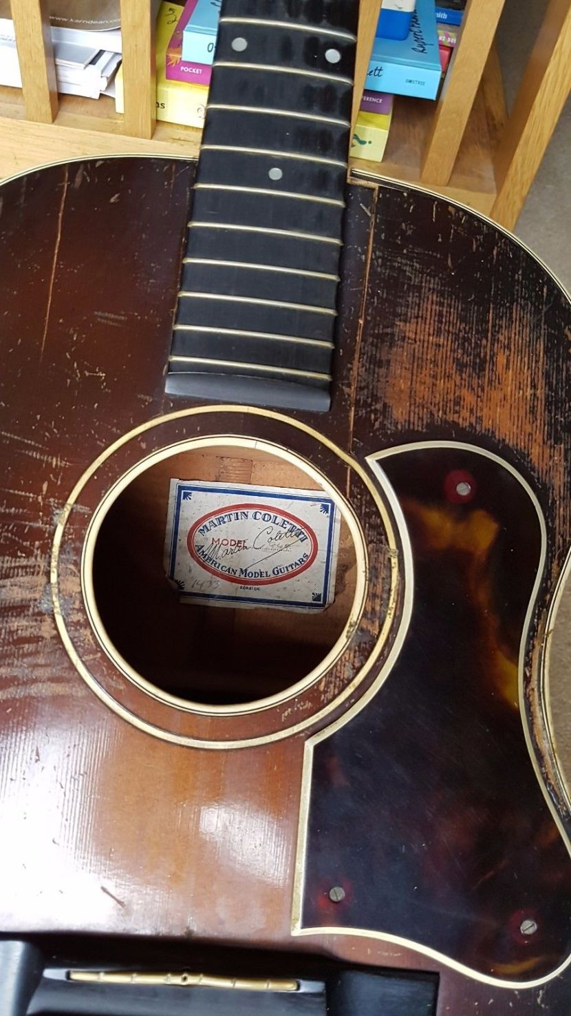 A well-played Martin Coletti G40 guitar. Top